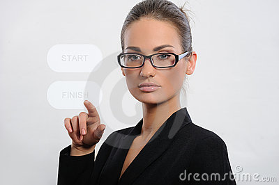 Business woman pressing a touchscreen button