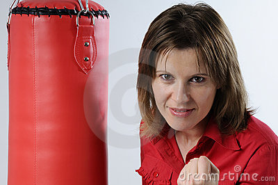 Business woman and punching bag
