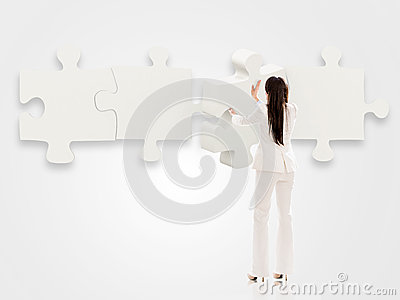 Business woman with a puzzle
