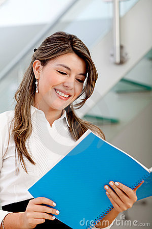 Business woman reading a brochure