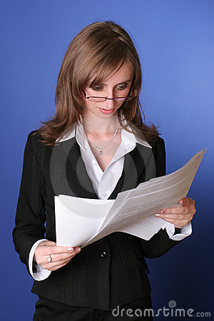 Business woman reading carefully a file