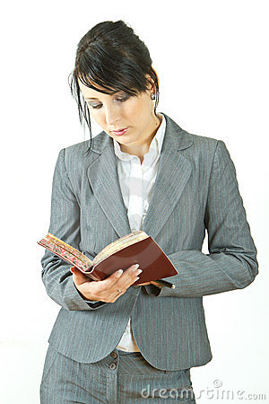 Business woman reading diary