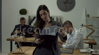 Business woman reading documents in folder stock video