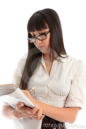 Business woman reading newspaper Stock Photo