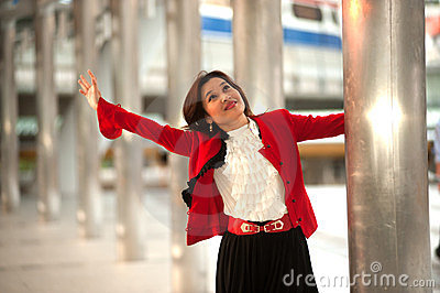 Business woman rejoice with arms outstretched .