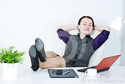 Business woman relax with legs on the table