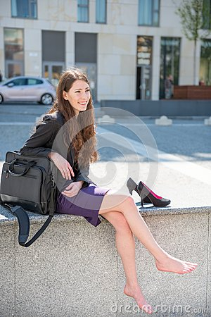 Free Business Woman Relaxing In Street Royalty Free Stock Photography - 24801357