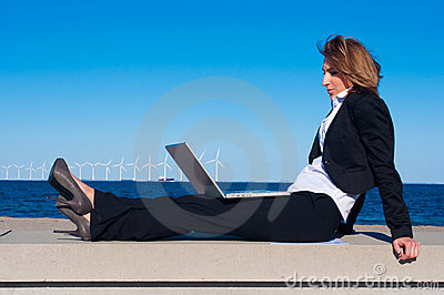 Business woman relaxing with laptop
