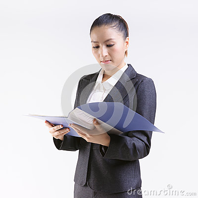 Business woman review files