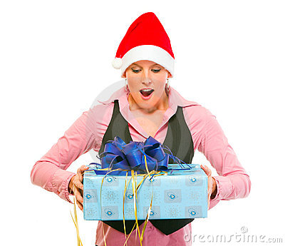 Business woman in Santa Hat looking on gift