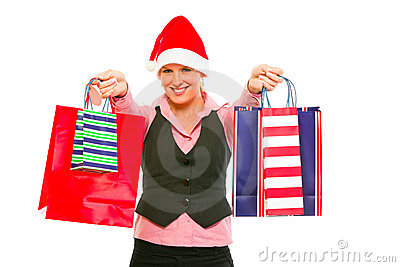 Business woman in Santa Hat with shopping bags