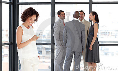 Business woman sending a text message
