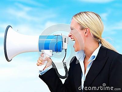 Business woman shouting through megaphone