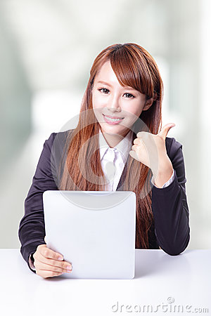 Business woman show thumb up and using tablet pc