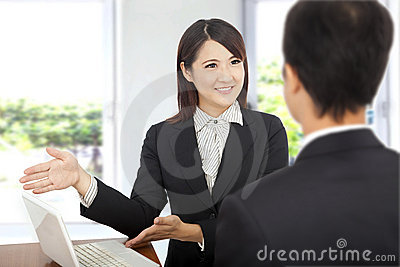 Business woman showing at laptop