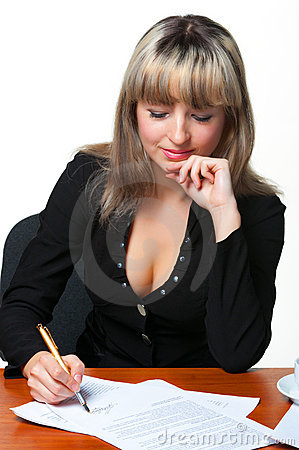 The business woman signs the contract