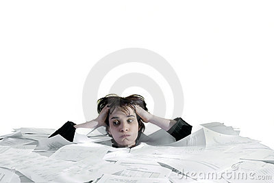 Business woman sinking in an overload of paperwork