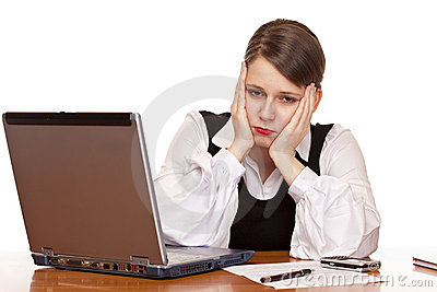 Business woman sits tired and stressed in office