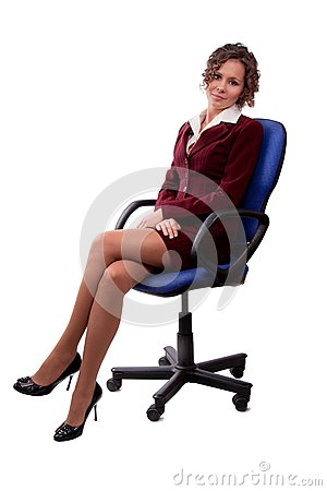 Business woman sitting on a chair.