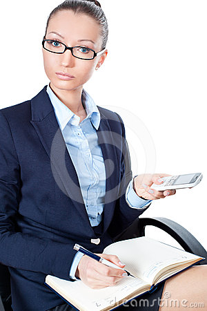 Business woman sitting on chair with mobile phone