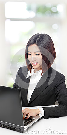 Business woman smile using notebook pc