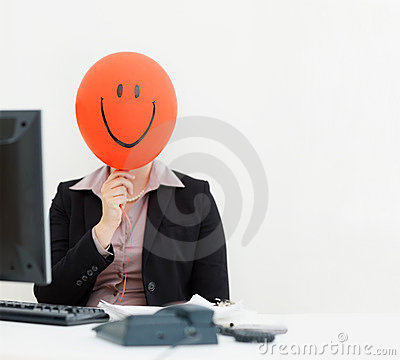 Business woman with a smiley face balloon