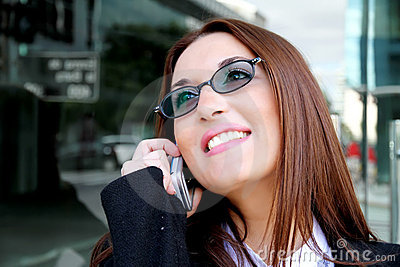 Business woman smiling on the phone