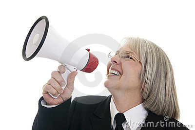 Business woman speaking into a bullhorn