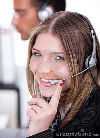 Business woman speaking through head phone