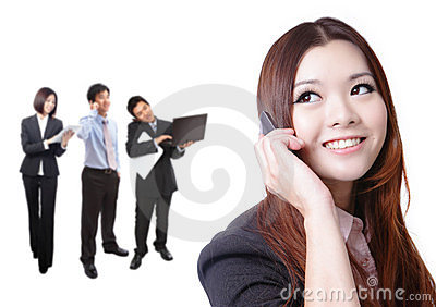 Business woman speaking phone with group
