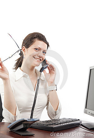Business woman, speaking at the phone on her desk