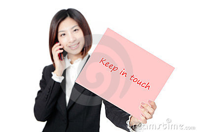 Business woman speaking phone and take paper