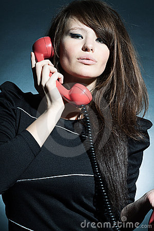 Business woman speaking on a  to phone.