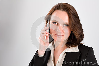 The business woman speaks by phone