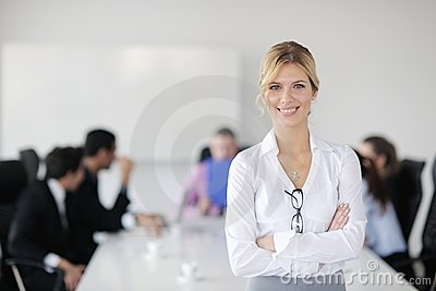 Business woman standing in front of with her staff