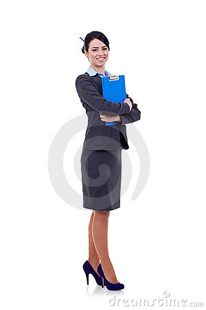Business woman standing with her clipboard