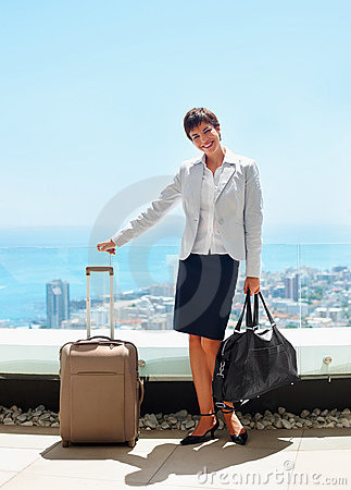 Business woman standing and holding bag