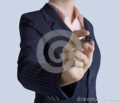 Business woman standing with marker in hand