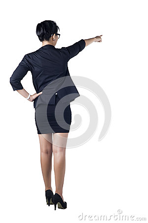Business woman standing and pointing.