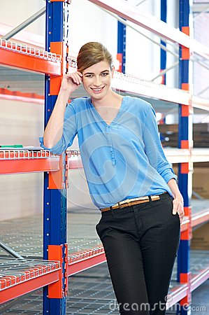 Business woman standing in warehouse