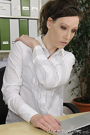 Business woman suffering from severe neck pain