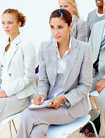 Business woman taking notes in  meeting