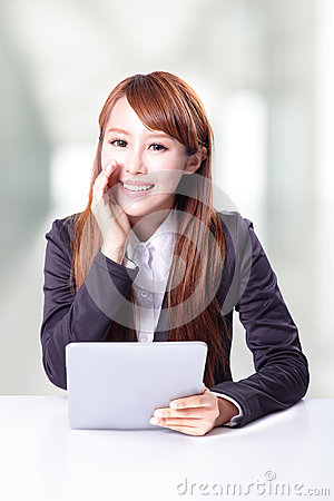 Business woman talking and using tablet pc