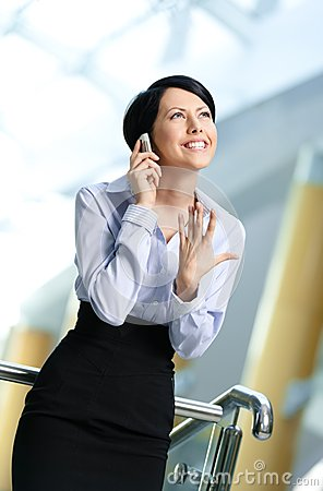Business woman talks on cellular phone