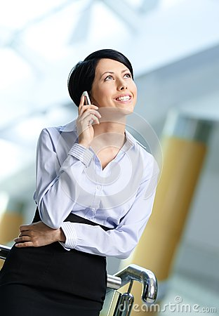 Business woman talks on phone