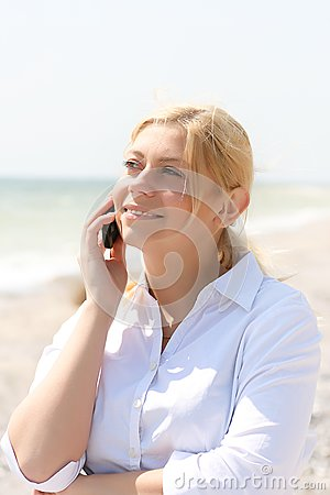 Business woman talks by phone