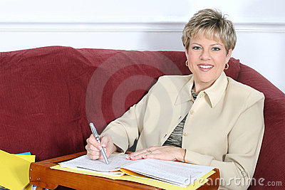 Business Woman or Teacher Working at Home on Couch