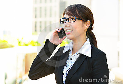 Business woman text on phone