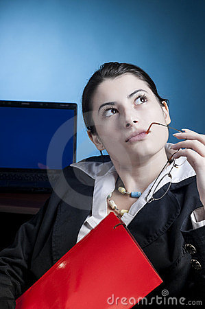 Business woman thinking at a problem