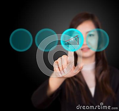 Business woman touching button